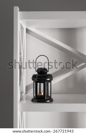interior and decor in the room, lantern for candles, black and white interior - stock photo
