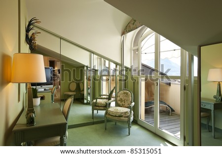 interior apartment, comfortable suite, attic room - stock photo