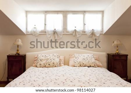 interior apartment, small loft furnished, bedroom - stock photo
