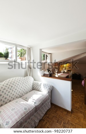 interior apartment, small loft furnished, living room - stock photo