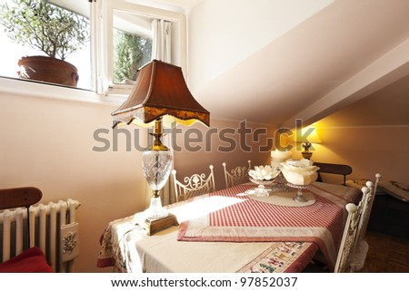 interior apartment, small loft furnished,table - stock photo