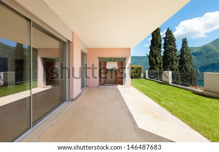 Interior apartment with garden, view from veranda - stock photo