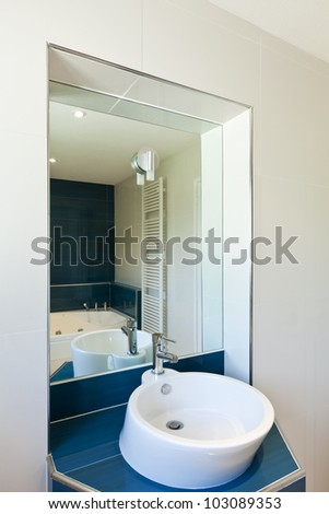 interior bathroom in modern house, sink and mirror - stock photo
