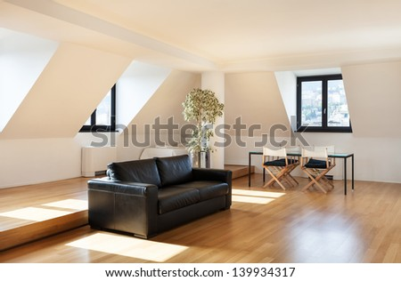 Interior, beautiful loft, hardwood floor, view living room - stock photo