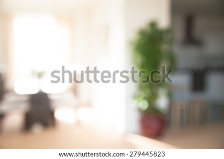 Interior blur background. Living room with big window, sofa, tree - stock photo