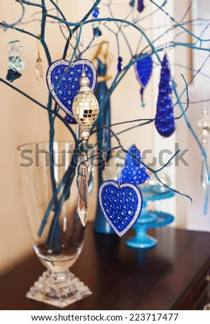 Interior Christmas decoration in blue and silver tones. - stock photo