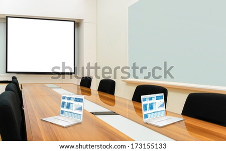 Interior conference room, meeting room, boardroom, Classroom, Office, Business data information on projector board and two laptop.  - stock photo
