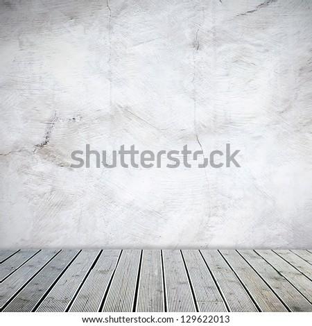 Interior corner in industrial building with wooden floor - stock photo