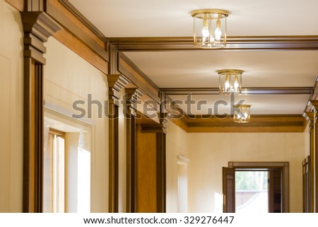Interior corridor in ecological house.Illuminated light bulb on the ceiling.The wide windows with views of green garden. Design facilities new and modern. - stock photo