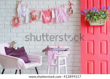 Interior decoration for shooting spring family in studio with bright pink elements - stock photo
