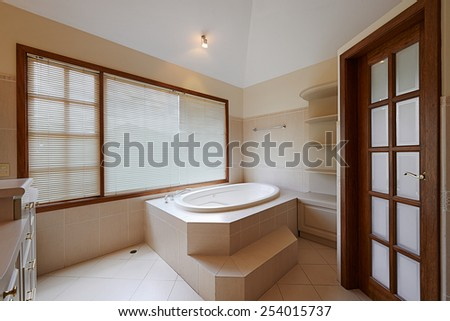 Interior design: Beautiful luxury bathroom with big bathtub - stock photo