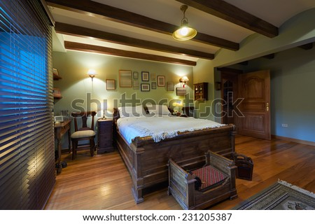 Interior design: Big rustic bedroom - stock photo