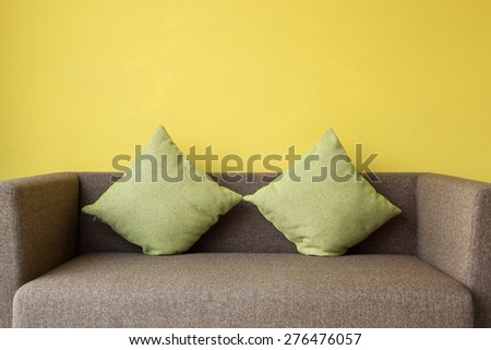 Interior design by brown sofa and green pillow in living room - stock photo