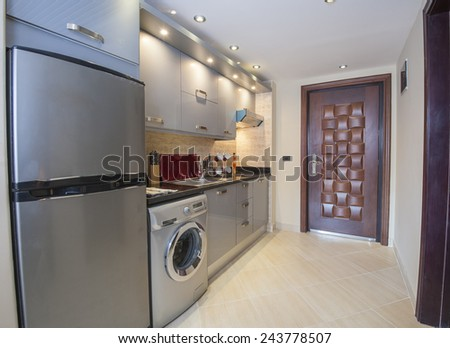 Interior design decor of kitchen in luxury apartment with appliances - stock photo