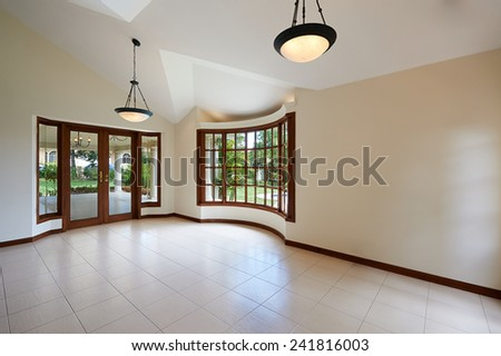 Interior design: Empty white room with big windows - stock photo