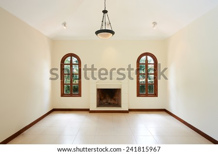 Interior design: Empty white room with fireplace and classic windows - stock photo