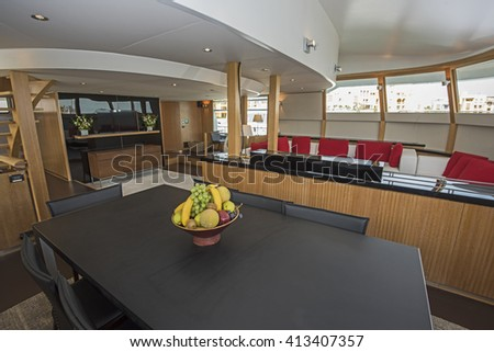 Interior design furnishing decor of the salon area in a large luxury motor yacht - stock photo