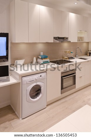 Interior design of a combination of a modern kitchen and a laundry - stock photo