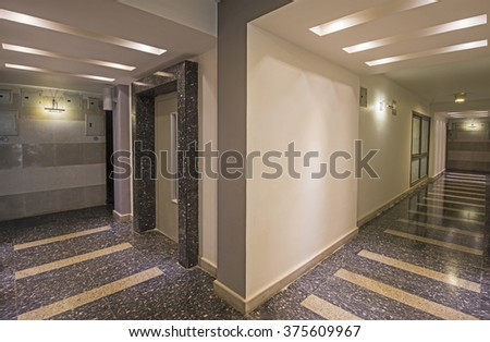 Interior design of a corridor inside a luxury modern apartment building - stock photo