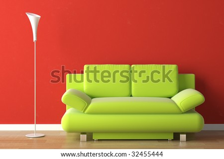 interior design of a green modern couch on a red wall - stock photo
