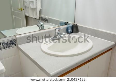 Interior design of a spacious and elegant bathroom - stock photo