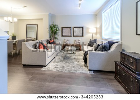 Interior design of luxury nicely decorated modern living room, suite with sofa and chairs. Interior design of a brand new house. - stock photo