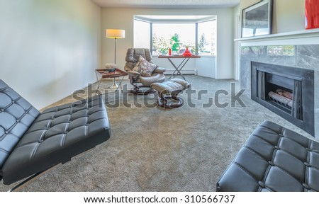 Interior design of luxury nicely decorated modern living room, suite with some leather chairs. Interior design. - stock photo