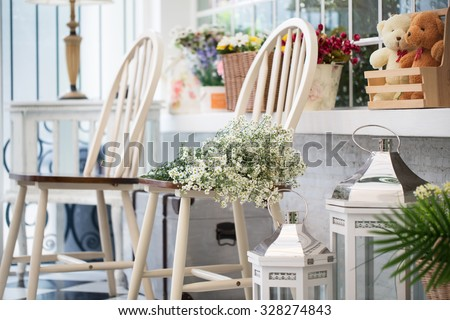 Interior design of room with furniture and flower in beige-white - stock photo