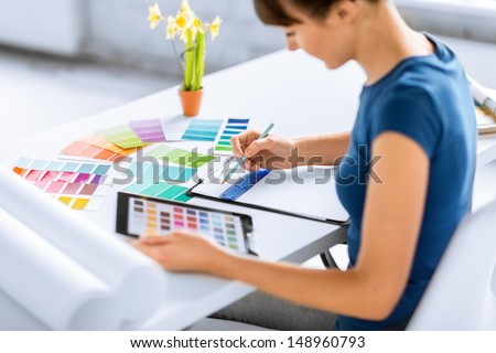interior design, renovation and technology concept - woman working with color samples for selection - stock photo
