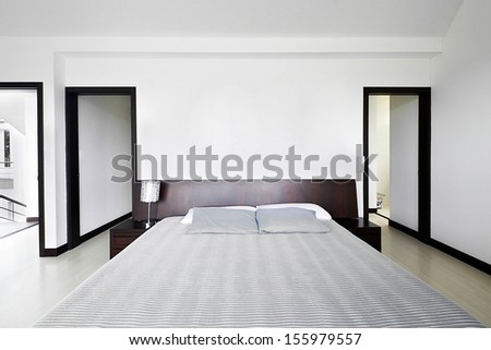 Interior design series: Modern Bedroom with big empty white wall - stock photo
