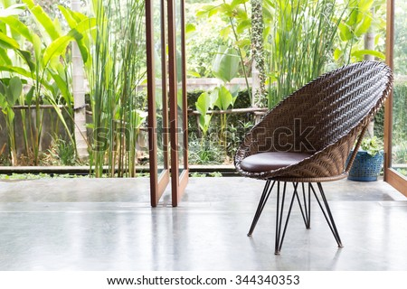 interior design, sofa furniture contemporary style in living room with natural garden outside the window - stock photo