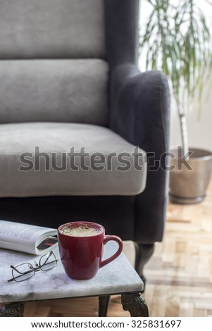 Interior design with armchair and marble table, close up - stock photo