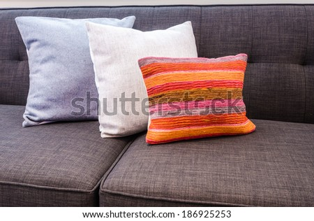 Interior design with couch, sofa with colourful designer cushions, pillows - stock photo
