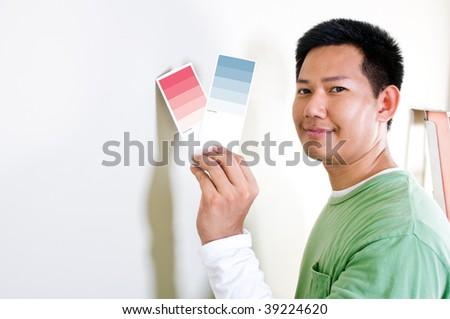 Interior designer choose color tone for wall - stock photo