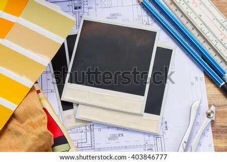 Interior designer's working table, an architectural plan of the house,  color palette and fabric samples in yellow shades, copy space on instant empty photos - stock photo