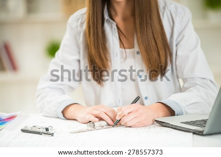 Interior designer working with illustration sketch at modern home office. - stock photo
