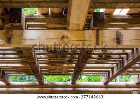 Interior detail of a wooden beam structure - stock photo