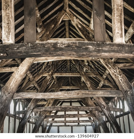 Interior detail of a wooden tithe barn structure. - stock photo