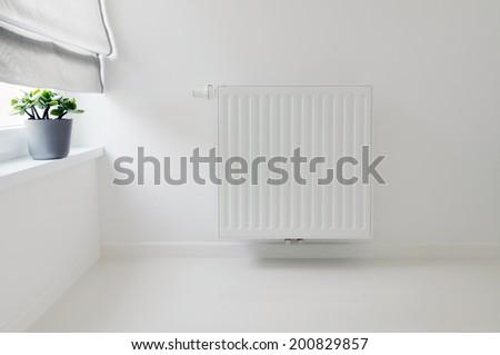 interior detail with radiator and white epoxy floor - stock photo