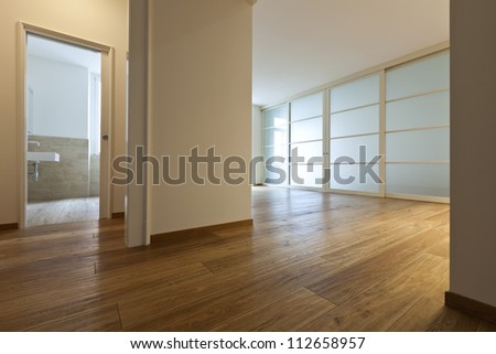 interior empty house with wooden floor, passage - stock photo