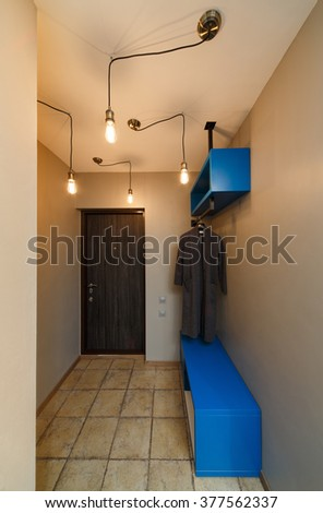 interior hallway in an apartment with a lot of incandescent light bulbs. - stock photo