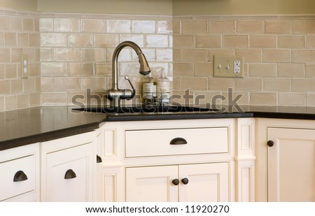 interior kitchen showing a close up of a corner sink - stock photo