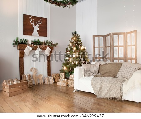 Interior living room with a Christmas tree and gifts - stock photo