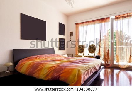 interior loft, furnished bedroom - stock photo