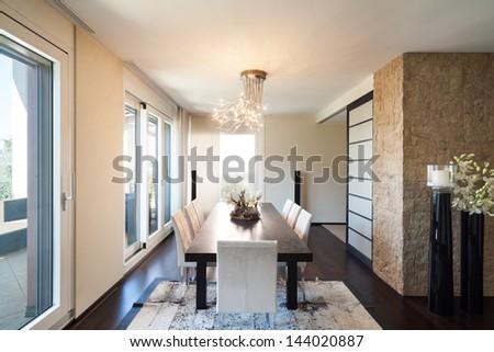 interior luxury apartment, beautiful dining room - stock photo