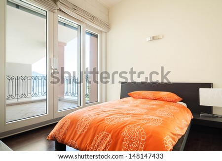 interior luxury apartment, bedroom with single bed  - stock photo