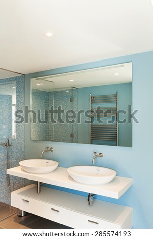 Interior, modern apartment, comfortable bathroom with two sinks - stock photo