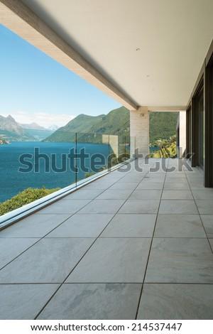 Interior, modern building, apartment, balcony view - stock photo