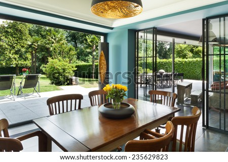 Interior, modern house, dining room, veranda view - stock photo