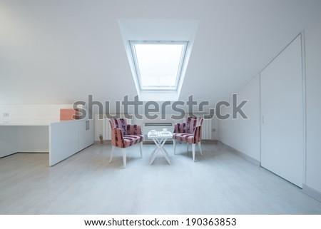 Interior of a bright white cozy loft in luxury apartment - stock photo